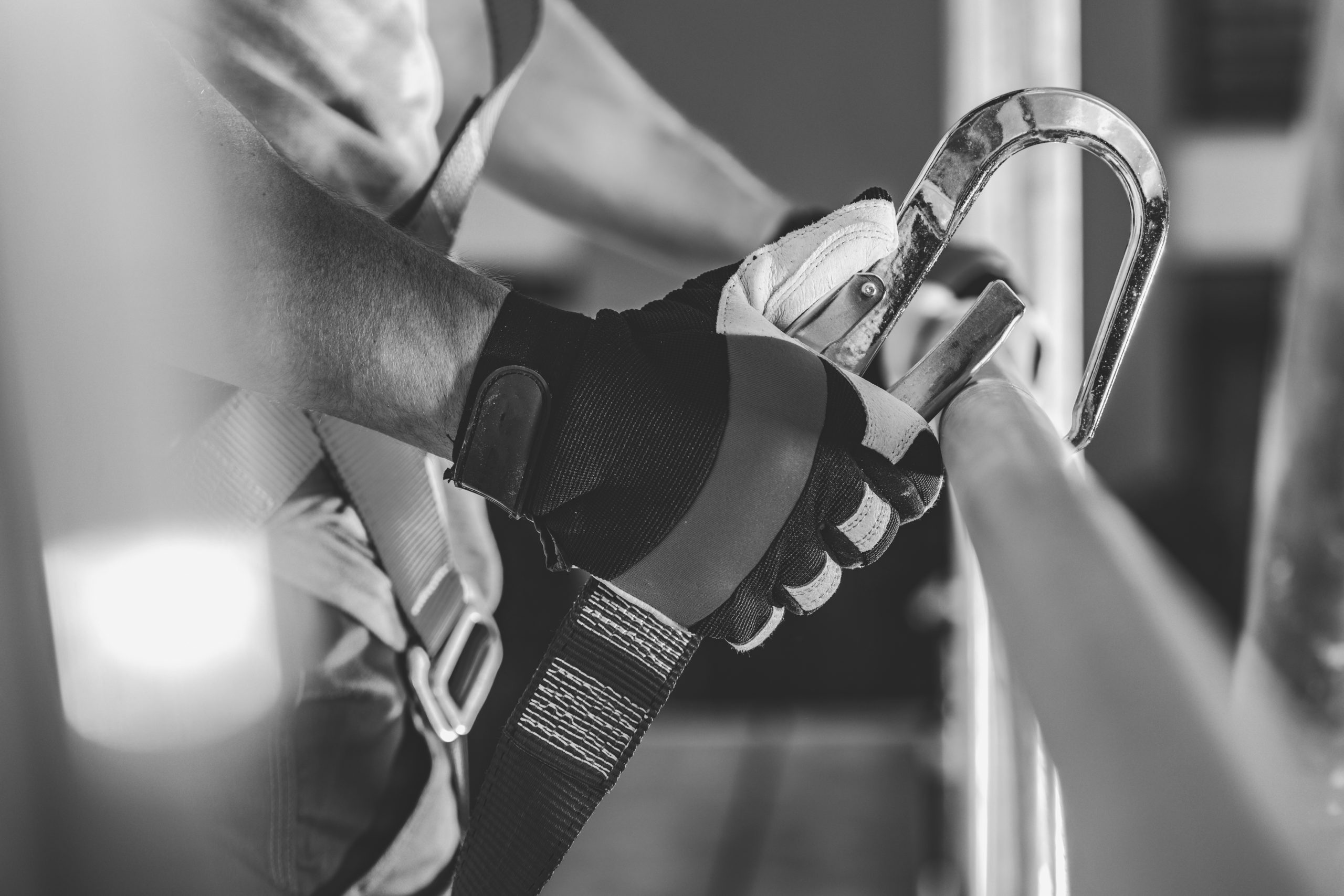 Safety Harness Hook Attaching to Scaffolding by Construction Worker.