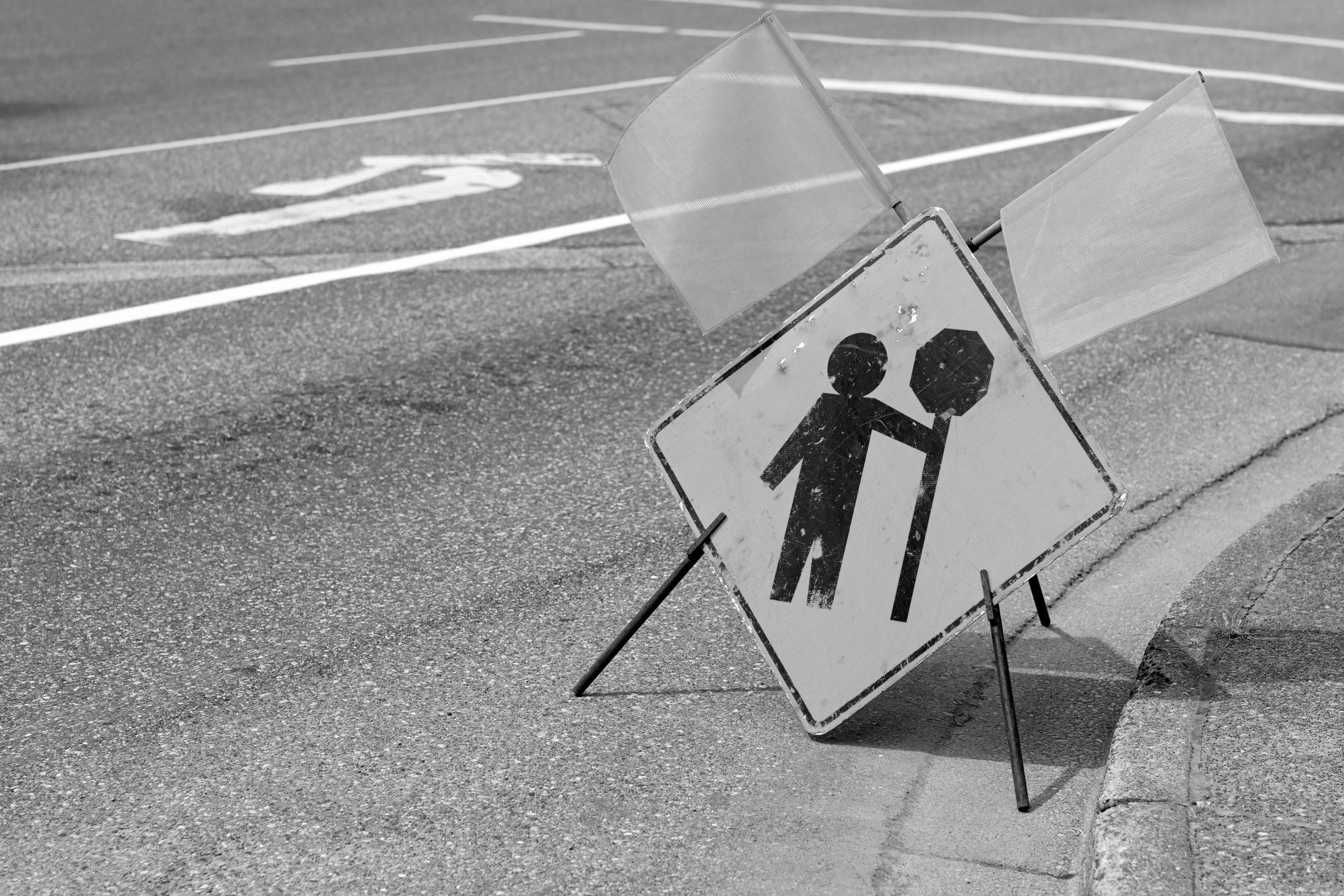 Construction flagger ahead sign on a street