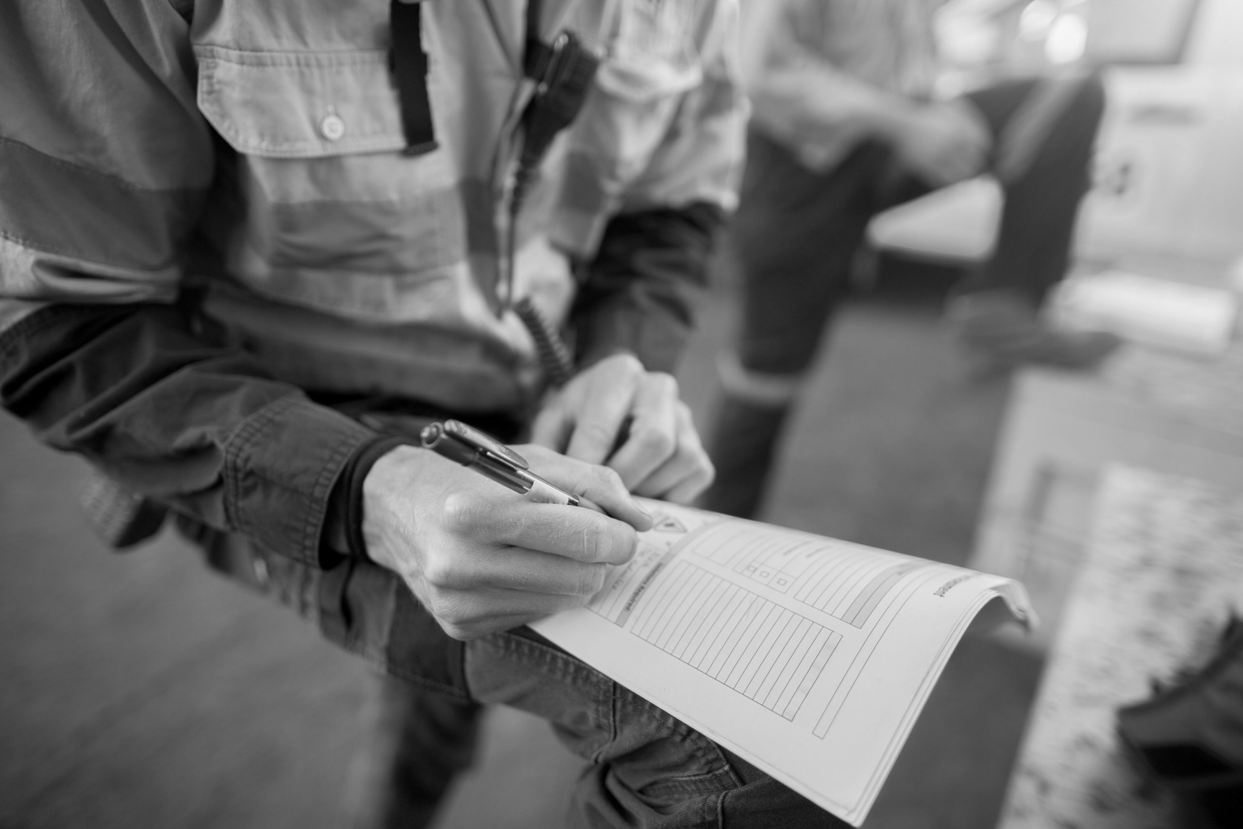 Rope access miner supervisor written checking reviewing inspecting issuer the paper work permit prior to work on construction mine site Perth, Australia